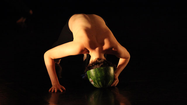 Performer dons watermelon helmet
