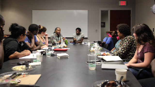Reggie Wilson talks with Fist and Heel performers and FSU student cohort members
