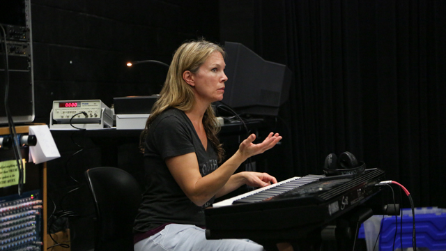 Dayna Hanson leads collaborators in <i>The Clay Duke</i> rehearsal.