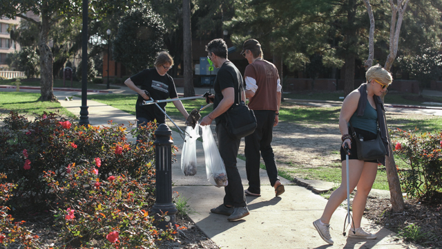 Johnson collaborators pick up trash during the Landis Green clean-up