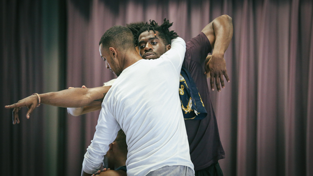 Jonathon Gonzalez, Shamar Watt and performers in rehearsal