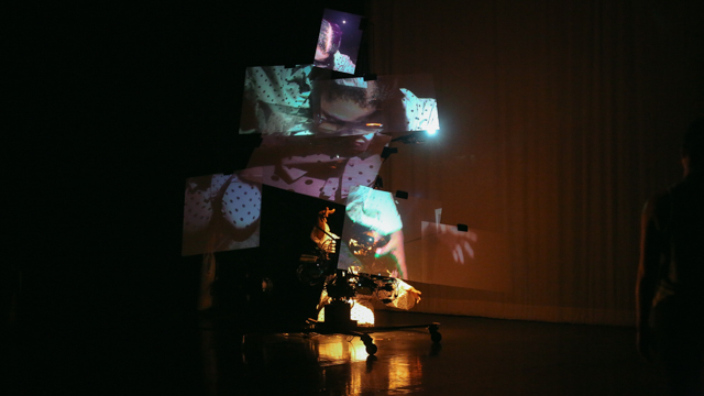Staycee Pearl performing with video installation sculpture