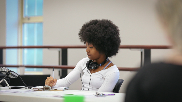 Jasmine Booker, FSU student, takes notes