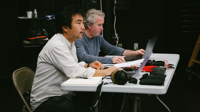 Nagai and lighting designer  Thomas Dunn watch rehearsal in the Black Box
