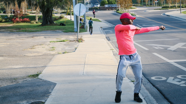 Jermone Beacham dancing in front of FAMU campus
