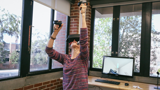 Ginger Krebs explores virtual reality equipment at FSU's Innovation Hub