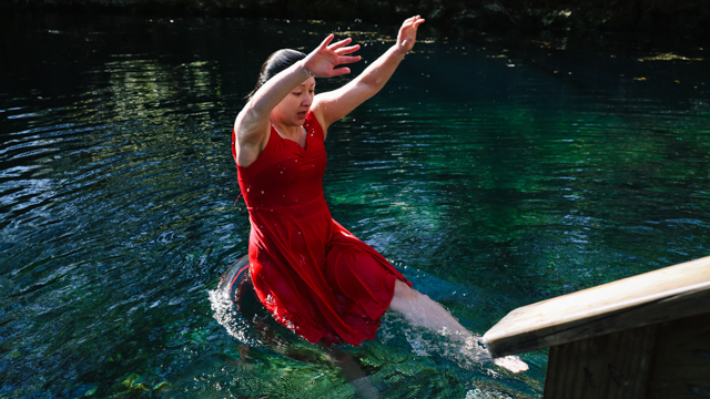 See jumps into the water at Madison Blue Springs during video shoot
