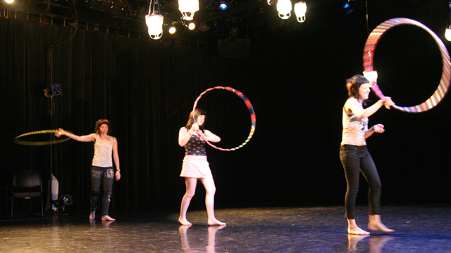 Hula hoopers explore a small shared motion at the direction of Emily Johnson.