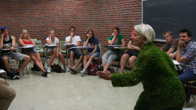 Carlson performs <i>Grass</i> for Theatre Professor George McConnell's Performing Arts class.