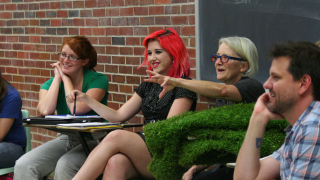 Carlson discusses her classroom performance of <i>Grass</i> with theatre students.
