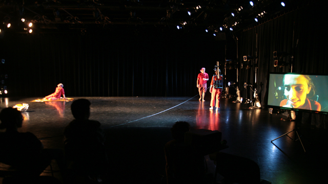 A full-stage shot of the dialogue duet