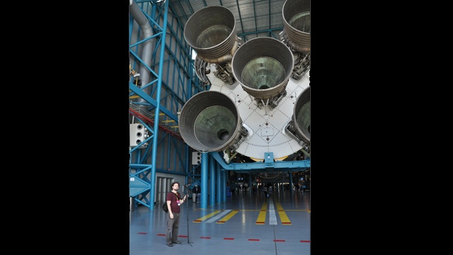 Collaborator Kevin Obsatz beside a rocket at Kennedy Space Center